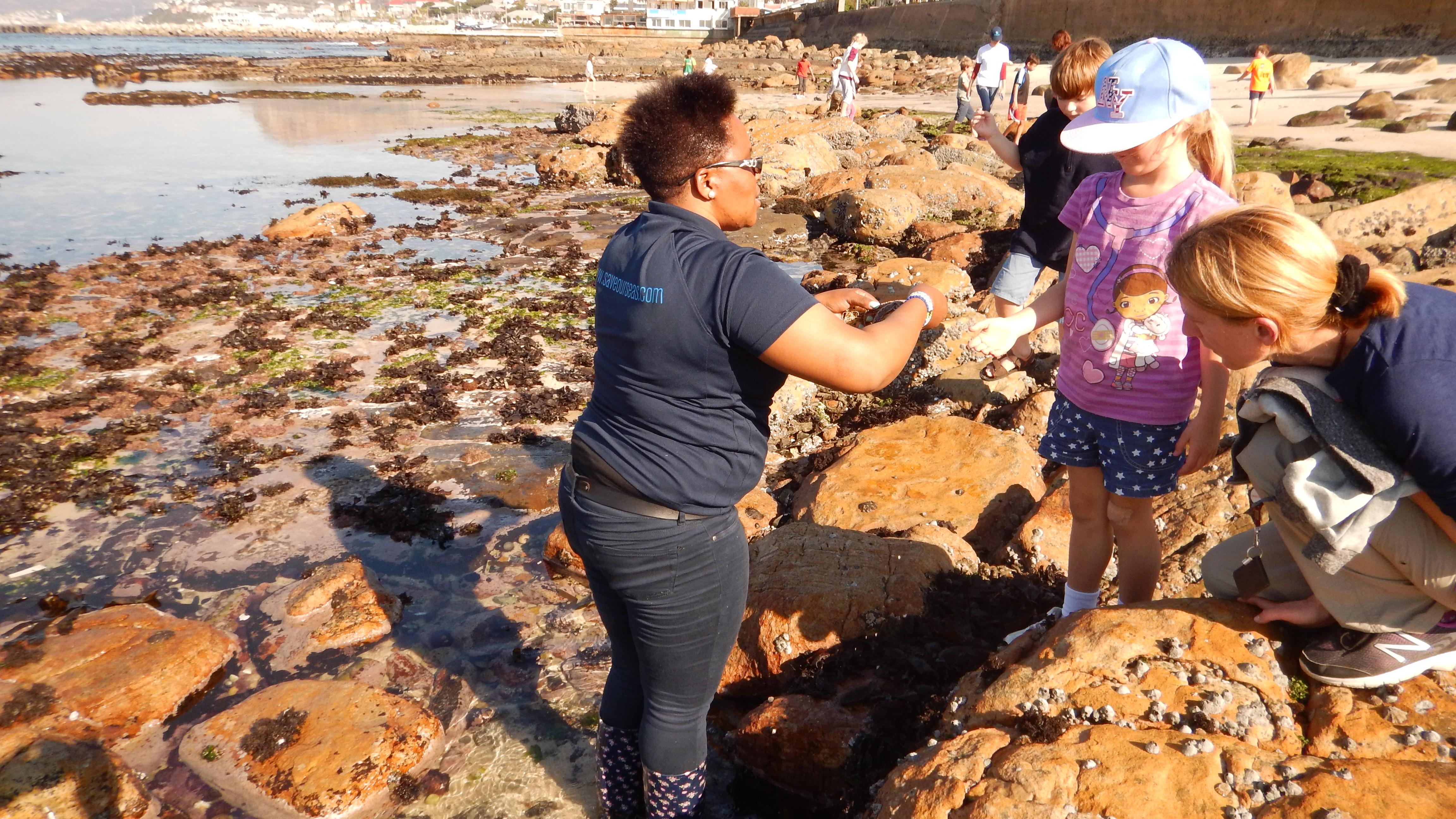 Assistant Educator Zanele Mayiya shows off some interesting seashore finds