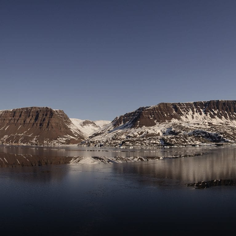 View of the southern coast of Disko Island Drift ice was finally starting to disappear at the end of the trip. © Photo by Julius Nielsen