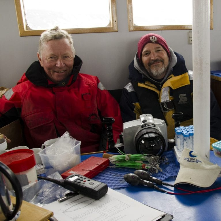 John and Peter enjoy the cosiness of the wheelhouse after tagging two sharks caught on the same line. © Photo by Julius Nielsen