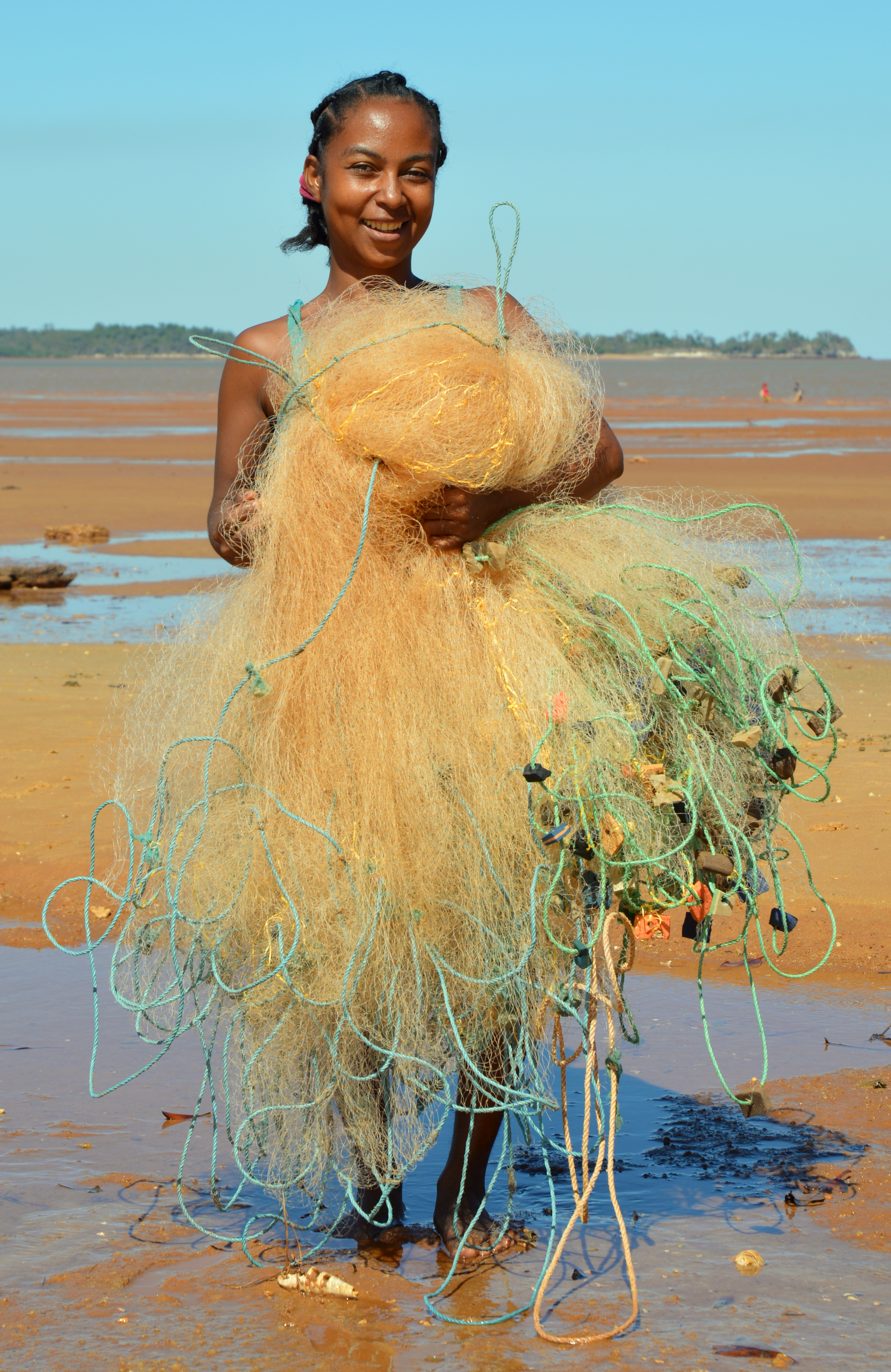 A woman on her way to fish from the beach, using a cast net, in northern Madagascar. Photo by Ruth Leeney.