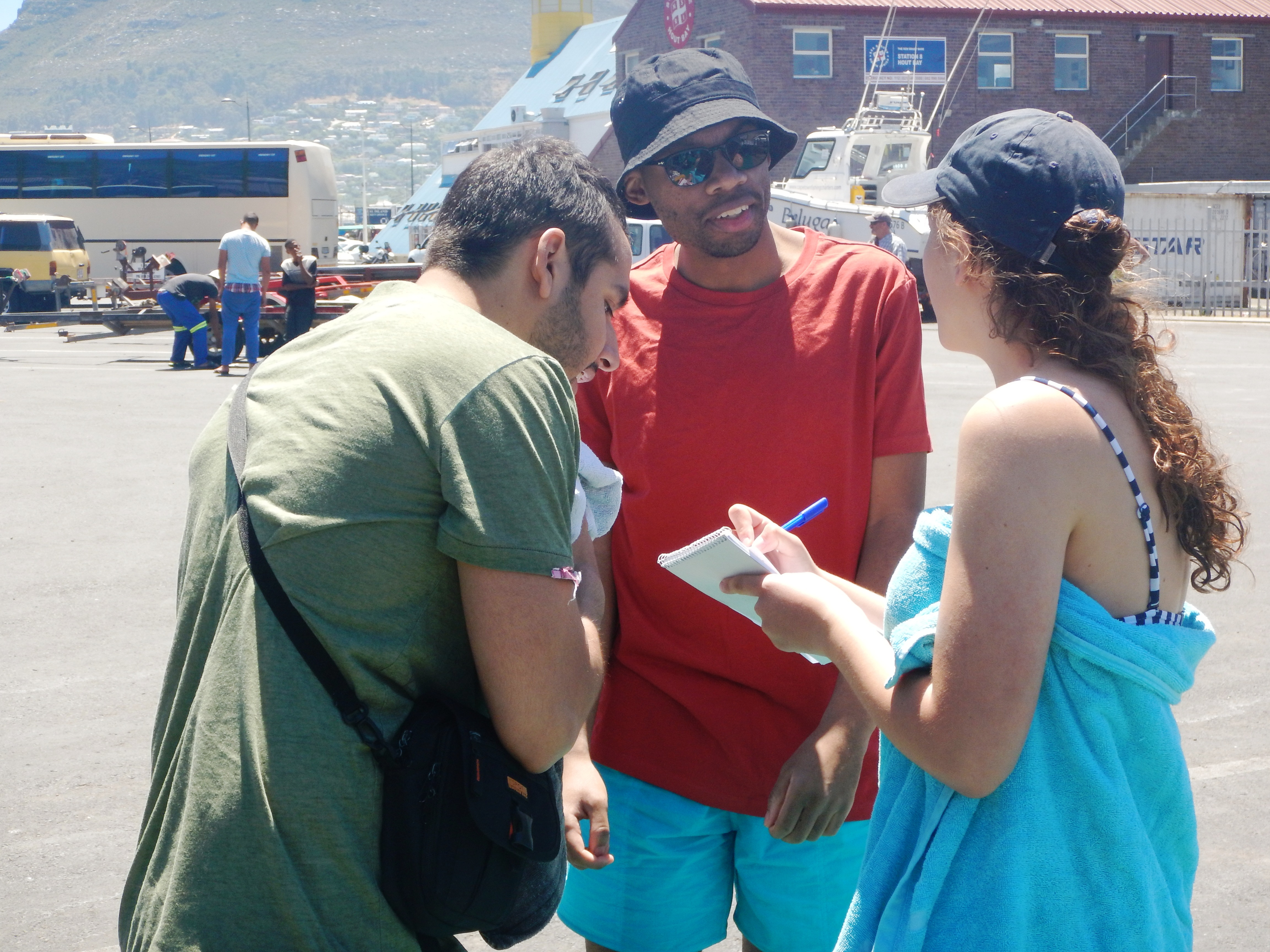 Casha interviews some tourists after their seal snorkel with Animal Ocean.