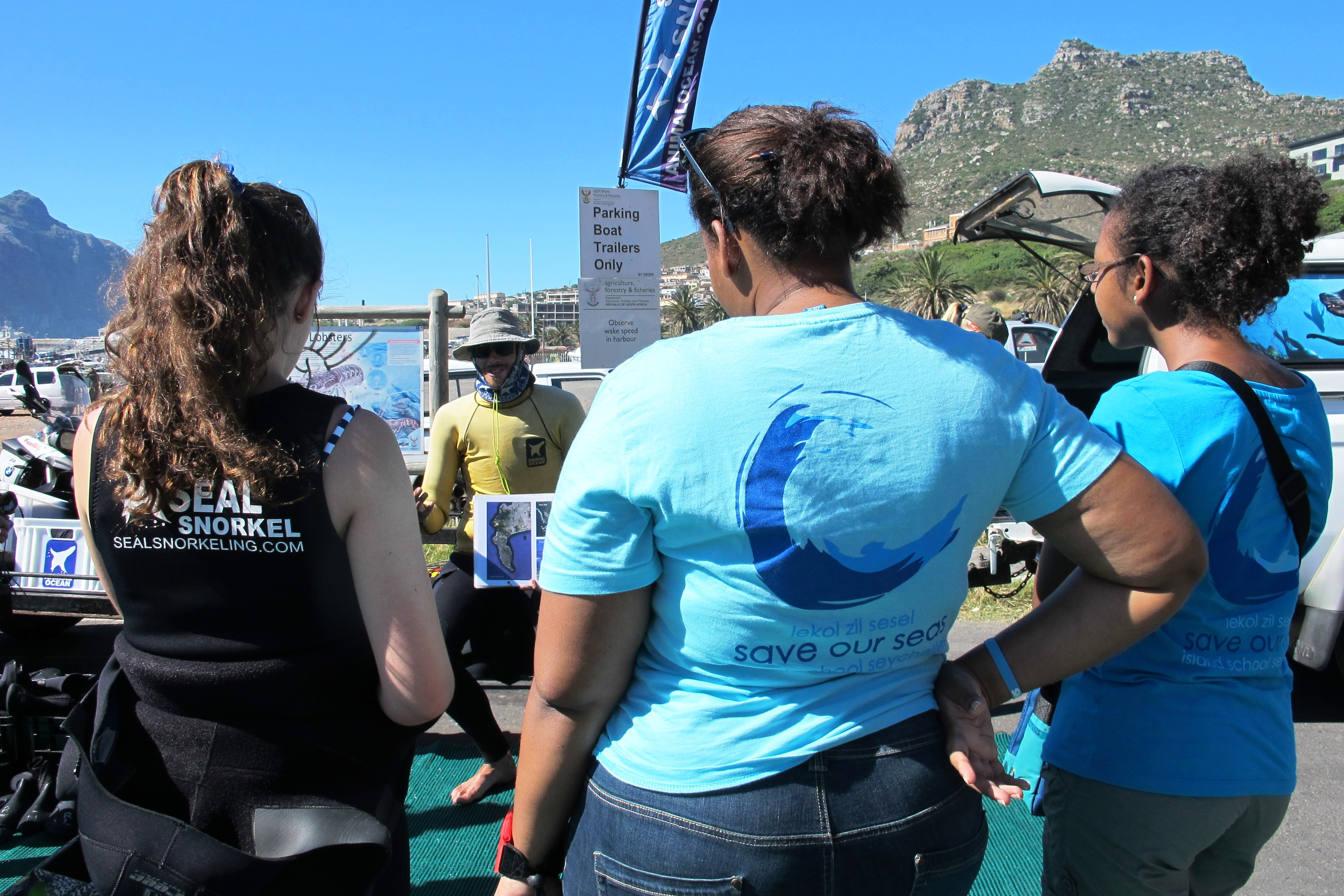 Casha, Anthea and Jaymee listen to a talk by Nathan from Animal Ocean before they begin their seal adventure.