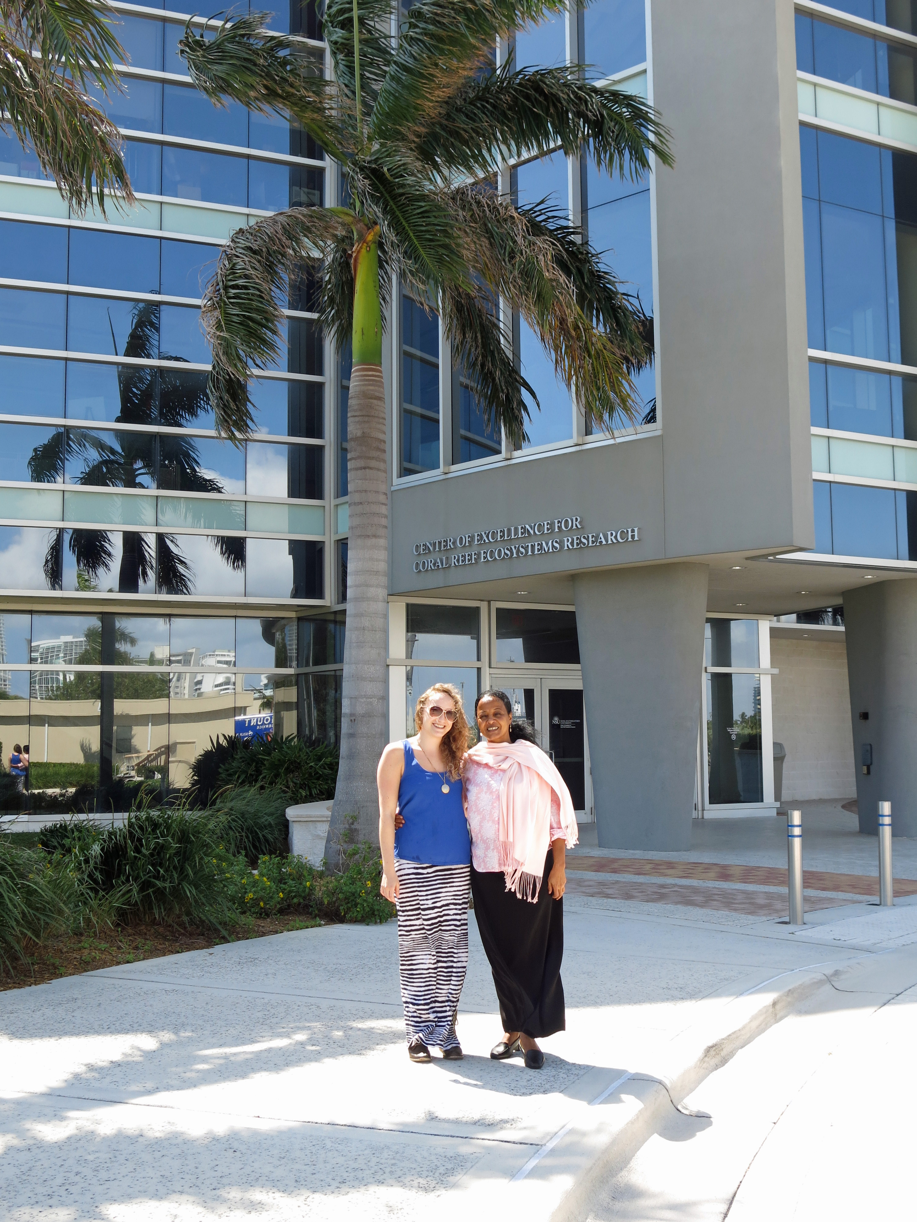 Igbal and Cassandra outside the SOSSRC laboratory building