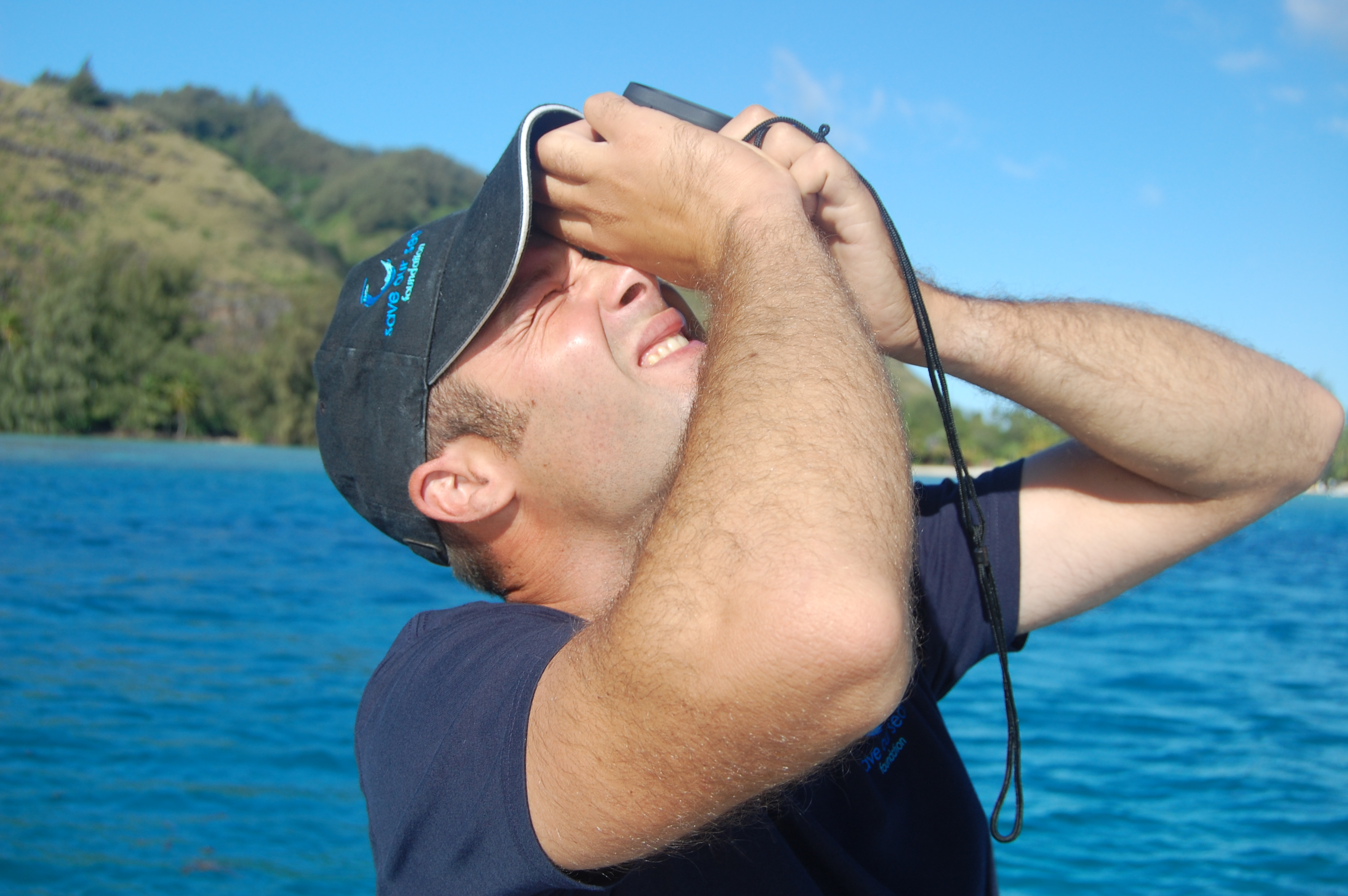 Measuring the altitude of the drone with an altimeter before starting a transect survey over the lagoon.