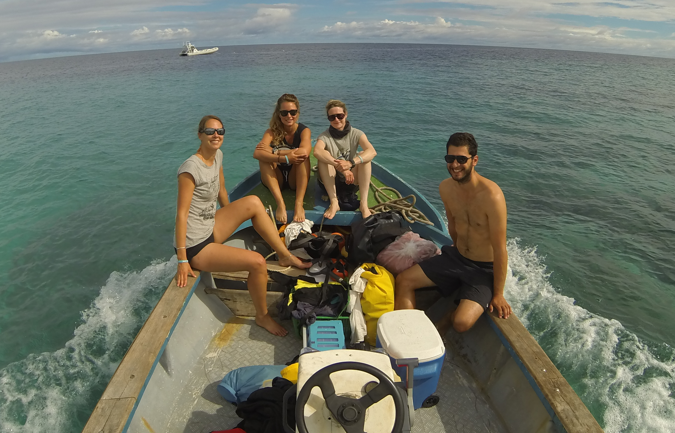 Our old atoll boat Creature loaded for a one-day sampling trip. Photo by Ornella Weideli