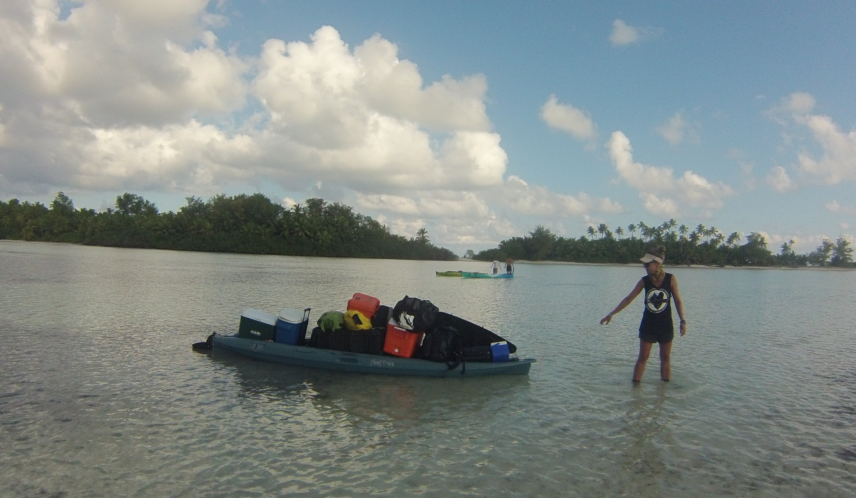 Ornella with a fully loaded kayak carrying field equipment, food, supplies and drinking water. Photo by Chantel Elston