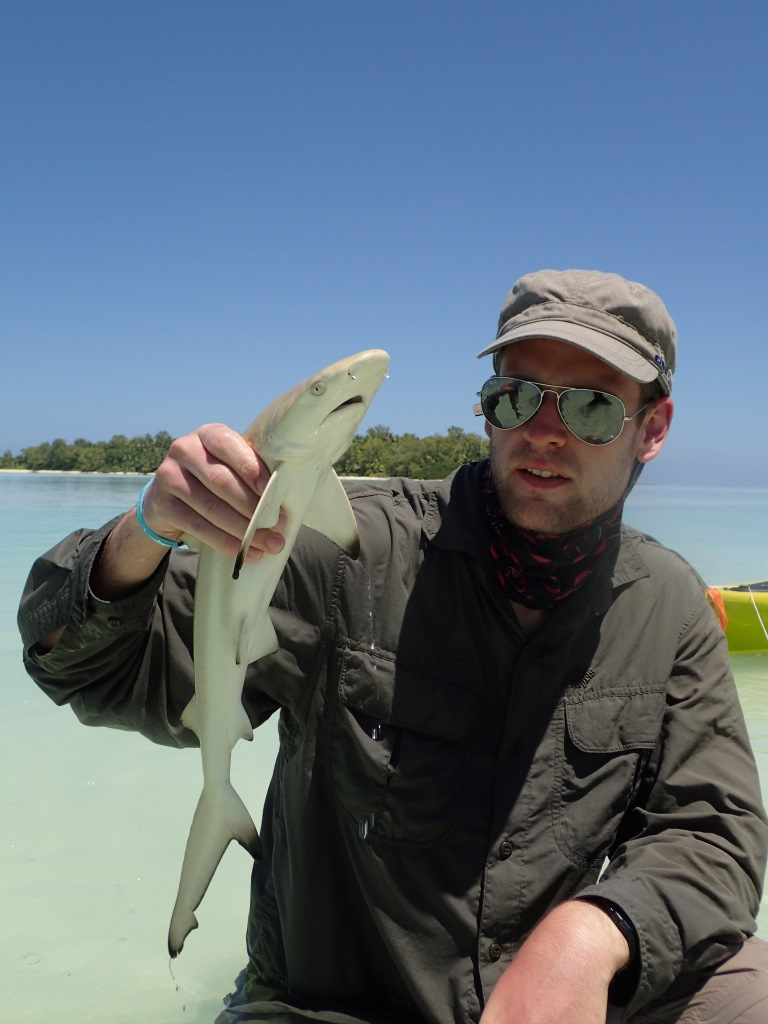 Morgan with a juvenile blacktip reef shark at the St. Joseph Atoll. Photo by Ornella Weideli | © Save Our Seas Foundation