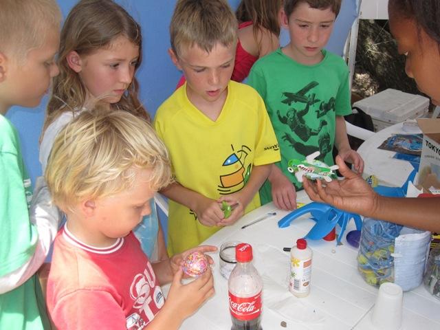 Academy student Dania helping children make turtles