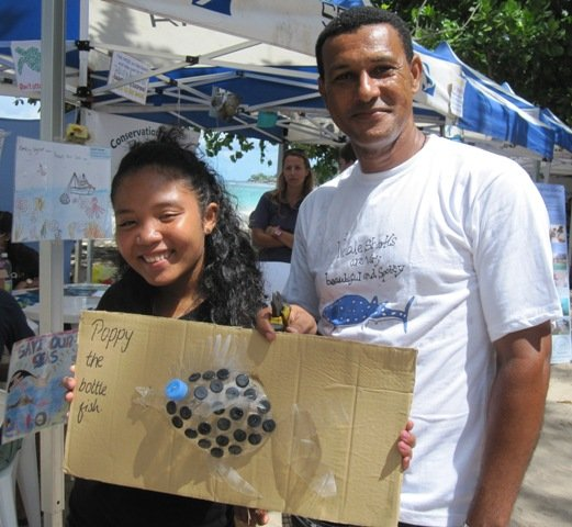 Academy student Vanessa with artist Robert Alexis and their recycled creation