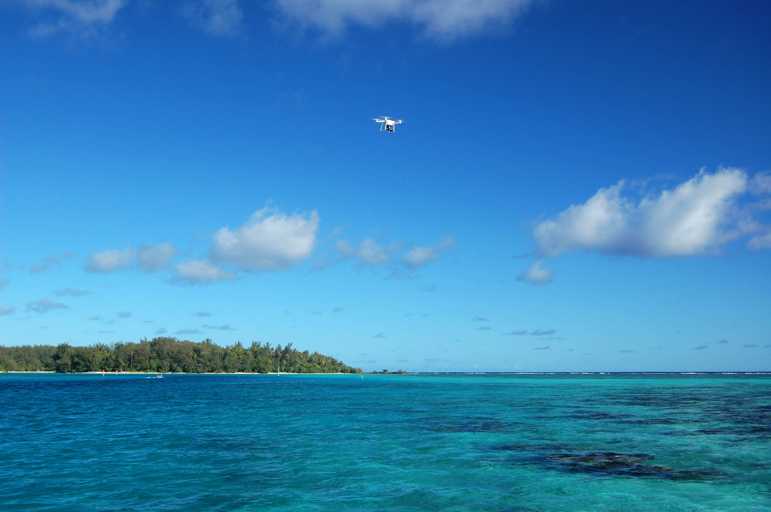 The drone flying over the shallow waters of the lagoon of Moorea.