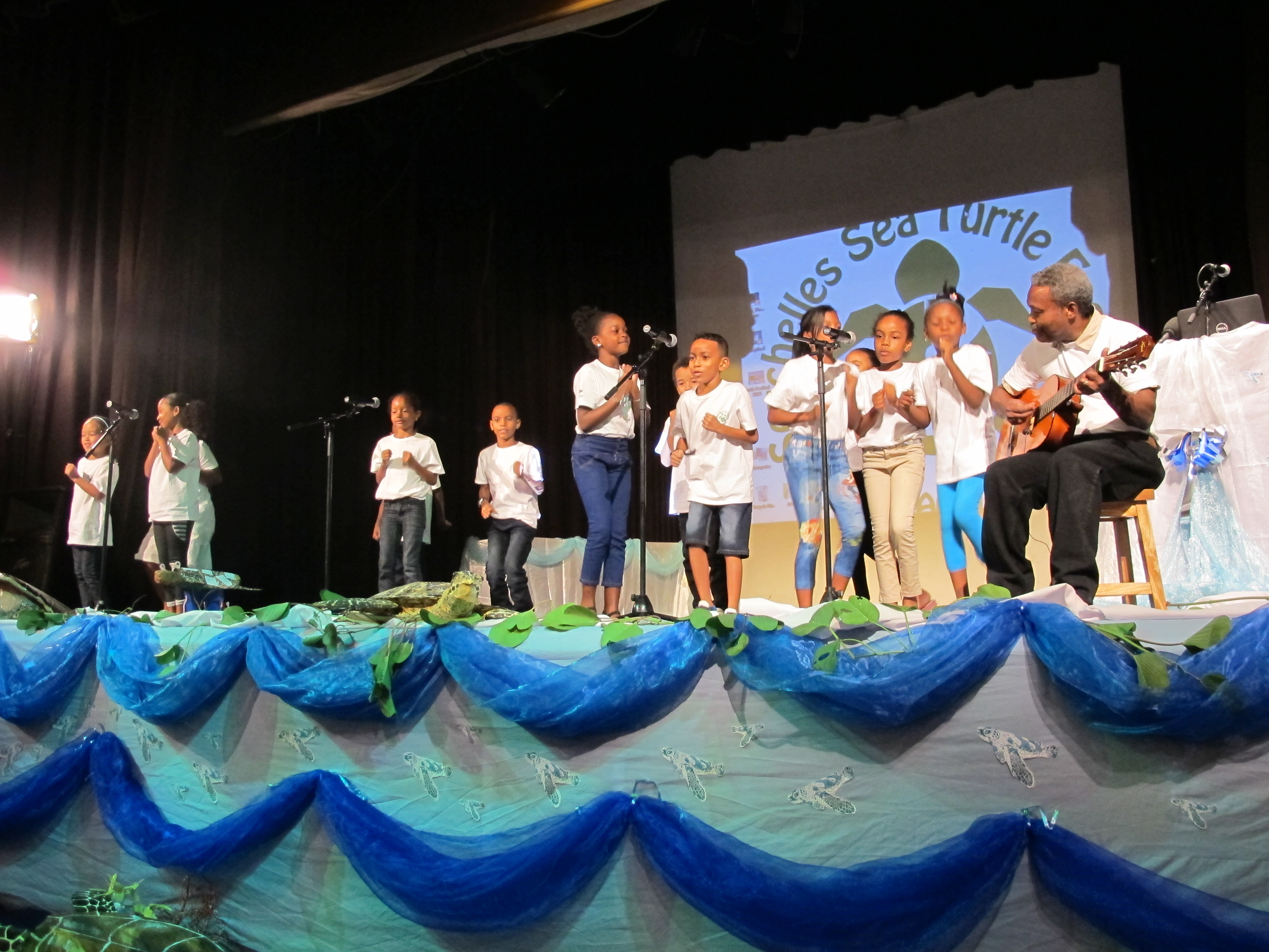 La Rosiere Primary School singing (with actions!) the 'Turtles in the Sea' Song. Photo: Abi March