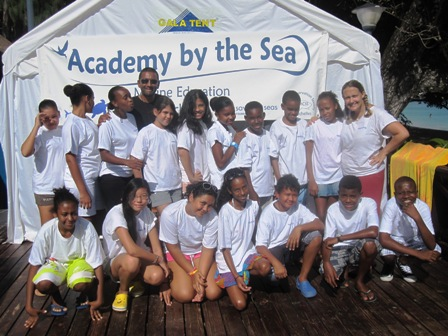 The students by their classroom by the sea